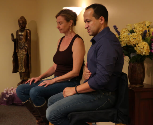 Colby Wilk healing session with a woman at workshop